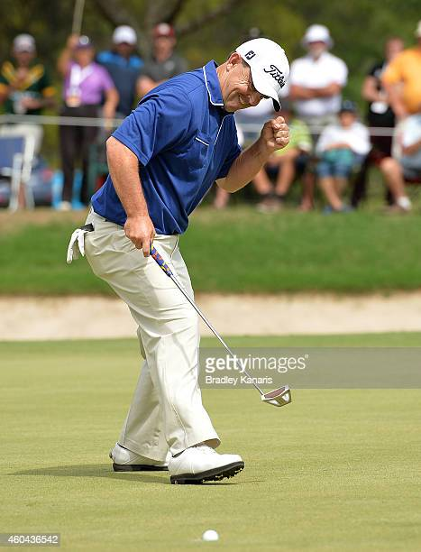 Greg Chalmers of Australia celebrates as he sinks his putt to take the lead on the final hole during day four of the 2014 Australian PGA Championship...