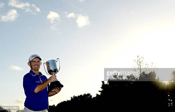 Greg Chalmers of Australia celebrates victory as he holds up the Kirkwood Cup after day four of the 2014 Australian PGA Championship at Royal Pines...