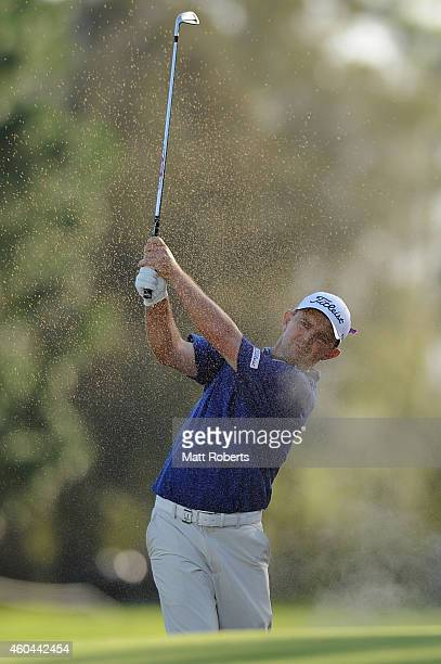 Greg Chalmers of Australia hits out of a bunker on the 18th hole during day four of the 2014 Australian PGA Championship at Royal Pines Resort on...