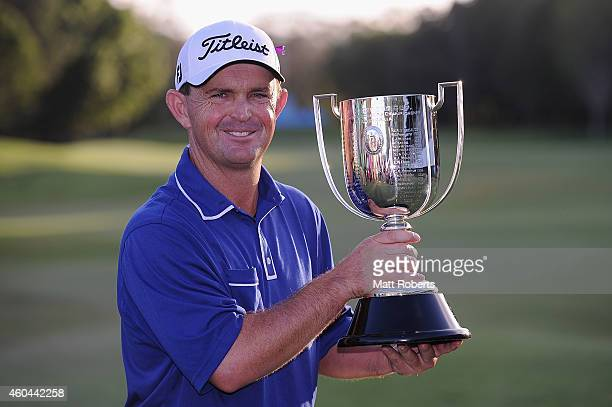 Greg Chalmers of Australia holds the Kirkwood Cup after winning the 2014 Australian PGA Championship at Royal Pines Resort on December 14, 2014 on...