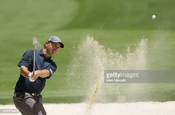 Greg Chalmers of Australia plays a bunker shot on the 5th hole during day four of the 2014 Australian Open at The Australian Golf Course on November...