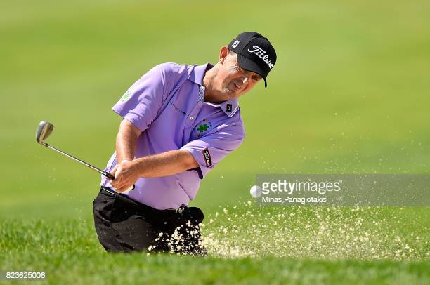 Greg Chalmers of Australia plays his shot out of the bunker on the 10th hole during round one of the RBC Canadian Open at Glen Abbey Golf Club on...