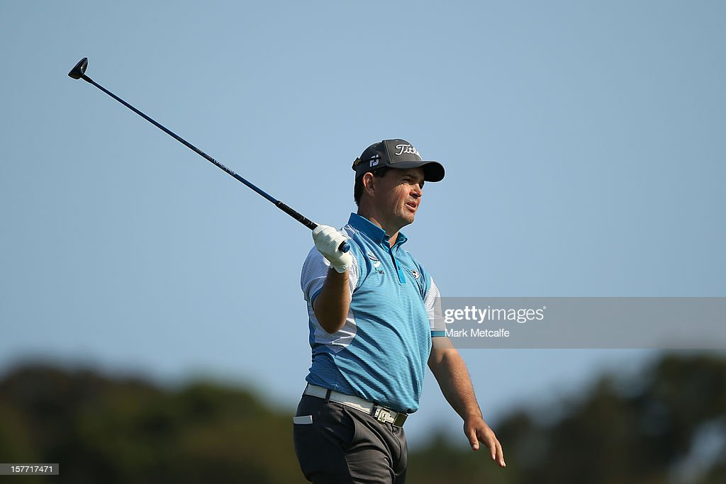 Greg Chalmers of Australia reacts after a shot during round one of the 2012 Australian Open at The Lakes Golf Club on December 6, 2012 in Sydney, Australia.