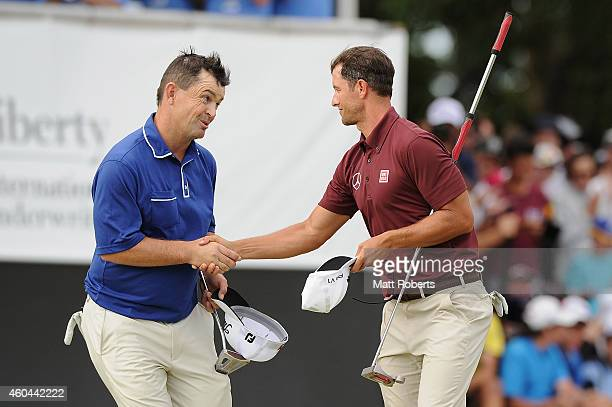 Greg Chalmers of Australia shakes hands with Adam Scott of Australia on the 18th hole during day four of the 2014 Australian PGA Championship at...