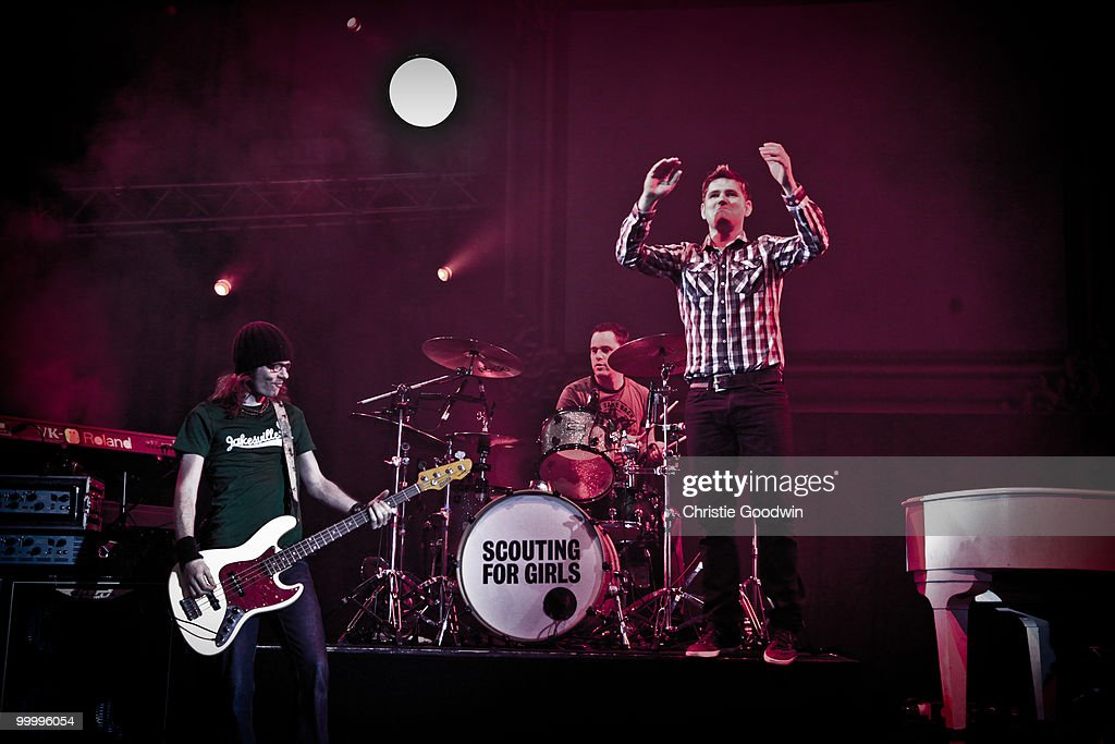 Greg Churchouse, Pete Ellard and Roy Stride of Scouting For Girls perform on stage at Hammersmith Apollo on May 19, 2010 in London, England.
