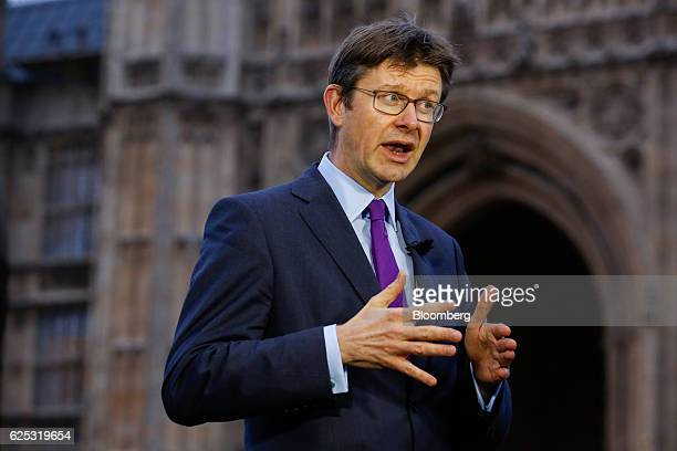 Greg Clark UK business secretary gestures while speaking during a Bloomberg Television interview in front of the Houses of Parliament in London UK on...