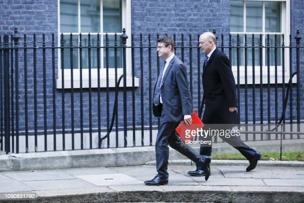 Greg Clark UK business secretary left and Chris Grayling UK transport secretary arrive for a weekly meeting of cabinet ministers at number 10 Downing...