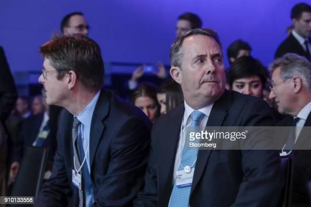 Greg Clark UK business secretary left and Liam Fox UK international trade secretary sit in the audience for the speech of UK Prime Minister Theresa...