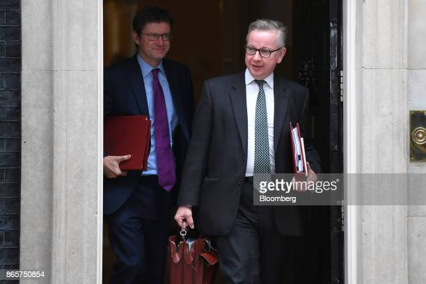 Greg Clark UK business secretary left and Michael Gove UK environment secretary depart following a cabinet meeting at number 10 Downing Street in...