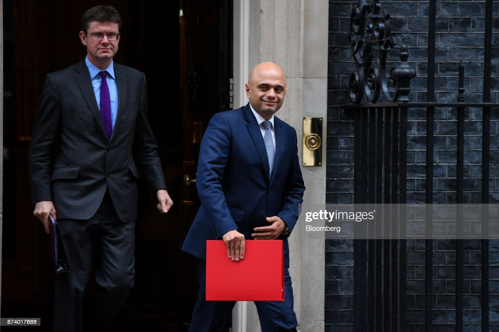 Greg Clark, U.K. business secretary, left and Sajid Javid, U.K. communities secretary, leave following a cabinet meeting at number 10 Downing Street in London, U.K., on Tuesday, Nov. 14, 2017. Analysts are more optimistic than the U.K. government that an agreement will be reached with the European Union next month to move Brexit talks on to trade even as Theresa Mays political troubles continue to weigh on the countrys beleaguered currency. Photographer: Chris J. Ratcliffe/Bloomberg via Getty Images