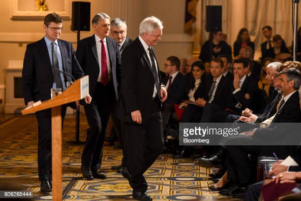 Greg Clark UK business secretary left Philip Hammond UK chancellor of the exchequer second left and David Davis UK exiting the European Union...