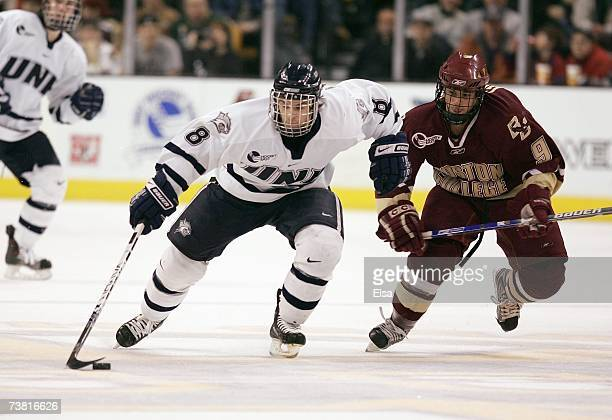Greg Collins of the New Hampshire Wildcats handles the puck during the Hockey East Tournament on March 17,2007 at TD Banknorth Garden in Boston,...