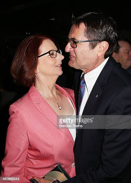 Greg Combat embraces former Prime Minister Julia Gillard at the launch of former cabinet minister Greg Combet's book 'The Fights of My Life' at...
