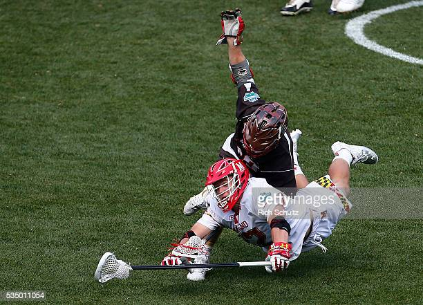Greg Danseglio of the Maryland Terrapins collides with Nick Esemplare of the Brown Bears in the third quarter during a semi final match in the NCAA...