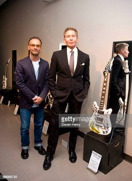Greg DiBenedetto publisher of Guitar Aficionado and designer Calvin Klein attend The Fashion Institute of Technology's annual yearend fashion show...