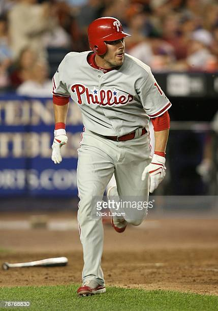 Greg Dobbs of the Philadelphia Phillies runs on his sacrafice fly which scored a run in the tenth inning against New York Mets at Shea Stadium...