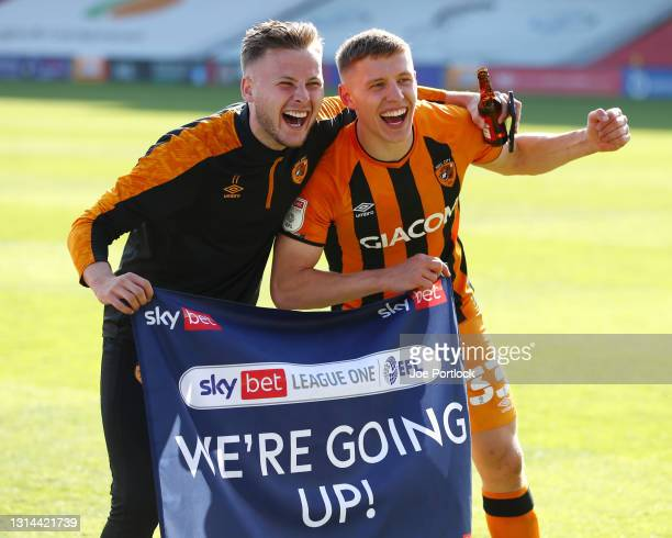 Greg Docherty and James Scott of Hull City celebrate winning promotion following the Sky Bet League One match between Lincoln City and Hull City at...