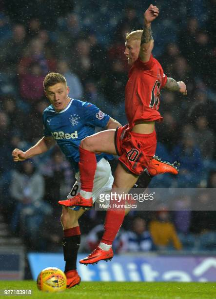 Greg Docherty of Rangers is challenged by Craig Sibbald of Falkirk during the Scottish Cup Quarter Final match between Rangers and Falkirk at Ibrox...