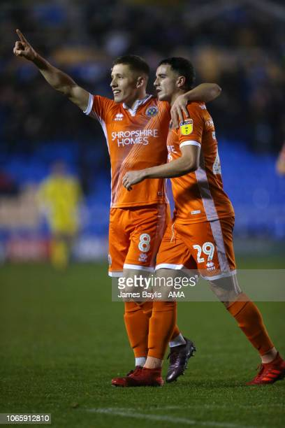 Greg Docherty of Shrewsbury Town celebrates after scoring a goal to make it 10 with Oliver Norburn during the Sky Bet League One match between...