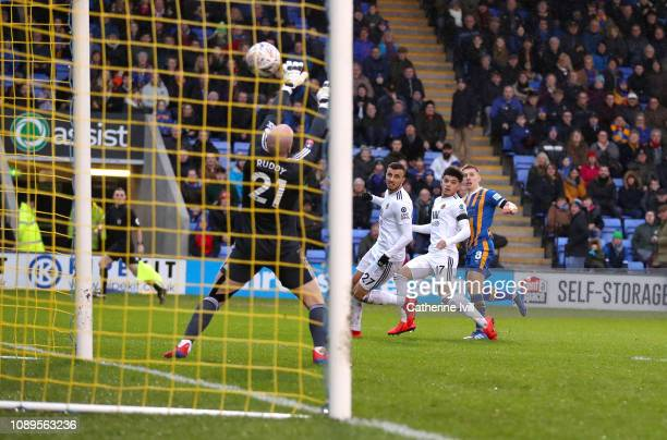 Greg Docherty of Shrewsbury Town scores his team's first goal during the FA Cup Fourth Round match between Shrewsbury Town and Wolverhampton...