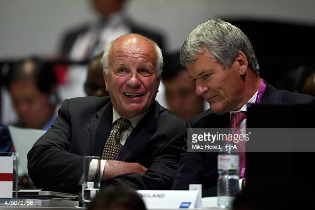 Greg Dyke, Chairman of the England Football Association talks to vice-chairman David Gill during the 65th FIFA Congress at the Hallenstadion on May...