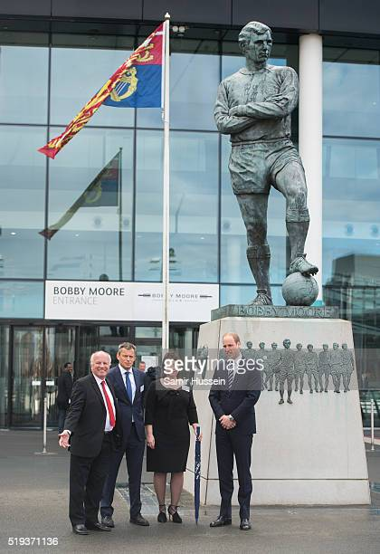 Greg Dyke Martin Glenn Julie Harrington and Prince William Duke of Cambridge stand in front of the Sir Bobby Moore statue as they attend Lunch To...