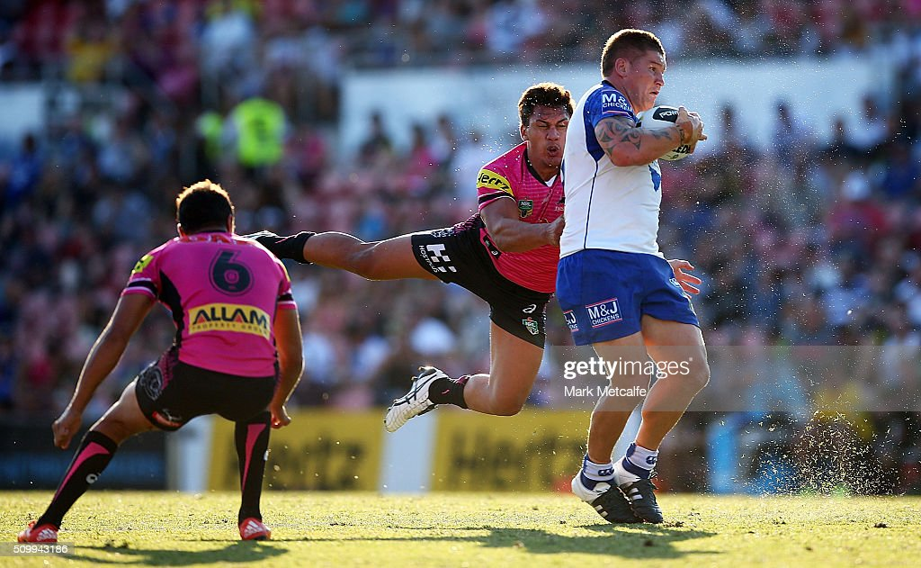 Greg Eastwood of the Bulldogs is tackled by Elijah Taylor of the Panthers during the NRL Trial match between the Canterbury Bulldogs and the Penrith Panthers at Pepper Stadium on February 13, 2016 in Sydney, Australia.