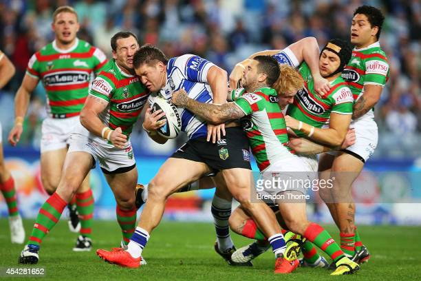 Greg Eastwood of the Bulldogs is tackled by the Rabbitohs defence during the round 25 NRL match between the Canterbury Bulldogs and the South Sydney...