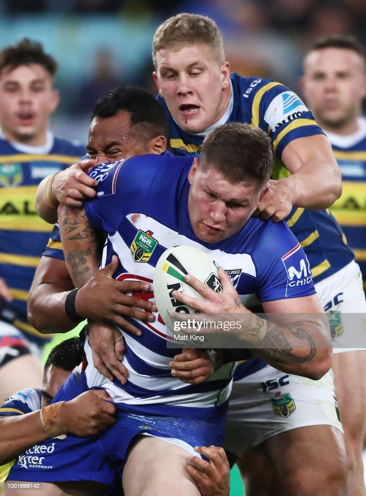 Greg Eastwood of the Bulldogs is tackled during the round 19 NRL match between the Parramatta Eels and the Canterbury Bulldogs at ANZ Stadium on July 19, 2018 in Sydney, Australia.
