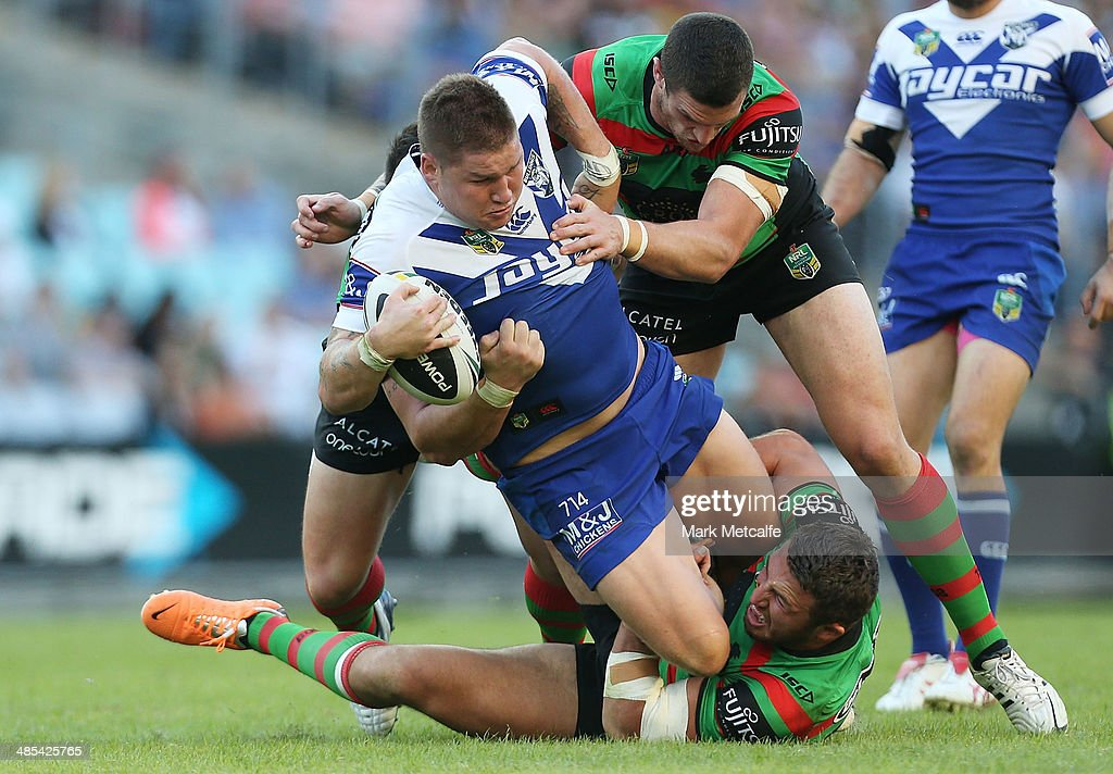 Greg Eastwood of the Bulldogs is tackled during the round seven NRL match between the South Sydney Rabbitohs and the Canterbury-Bankstown Bulldogs at ANZ Stadium on April 18, 2014 in Sydney, Australia.
