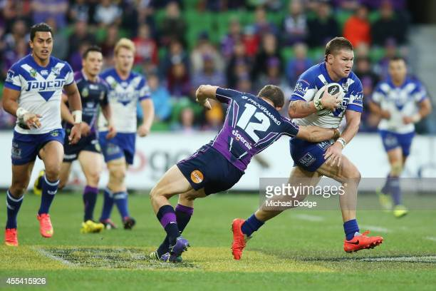 Greg Eastwood of the Bulldogs runs pasyt Ryan Hoffman of the Storm during the NRL 2nd Elimination Final match between the Melbourne Storm and the...