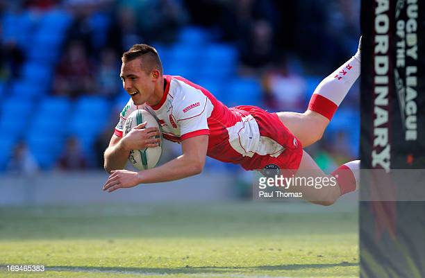 Greg Eden of Hull KR dives into score a try during the Super League Magic Weekend match between Hull FC and Hull Kingston Rovers at the Etihad...