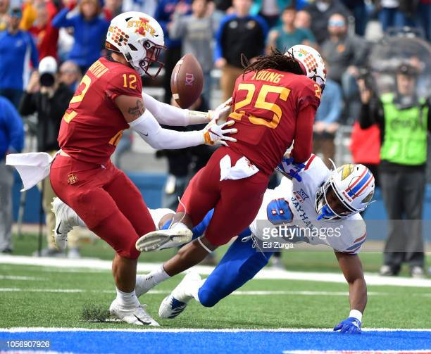 Greg Eisworth and defensive back Datrone Young of the Iowa State Cyclones break up a pass intended for wide receiver Jeremiah Booker of the Kansas...