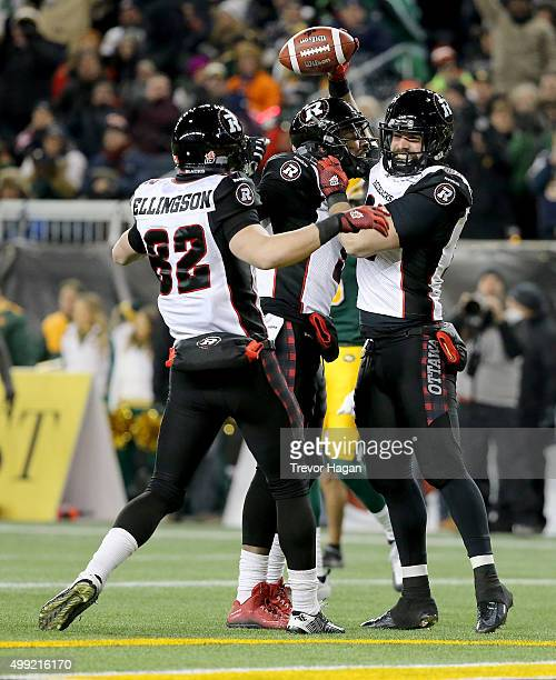 Greg Ellingson Ernest Jackson and Patrick Lavoie of the Ottawa Redblacks celebrate after Lavoie scored against the Edmonton Eskimos during first half...