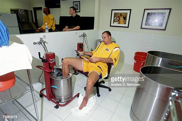 Greg Foster of the Los Angeles Lakers gets treatment on his foot prior to game two of the 2001 NBA Finals against the Philadelphia 76ers played June...