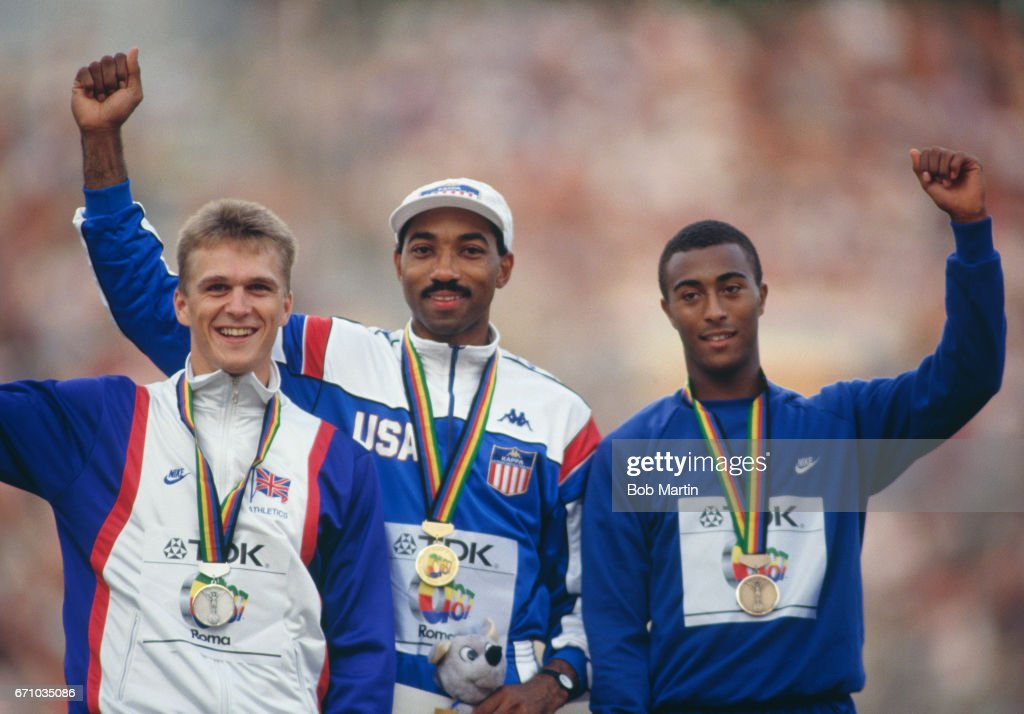 Greg Foster of the United States ( C ) celebrates his gold medal with silver medallist Jonathan Ridgeon ( L ) and bronze medallist Colin Jackson of Great Britain after the Men's 110 metres Hurdles event of the IAAF World Athletics Championships on 3 September 1987 at the Stadio Olimpico in Rome, Italy.