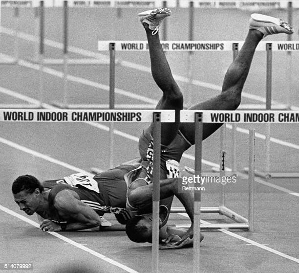 Greg Foster winds up upside down after a collision with Mark McKoy duirng finals of 60m hurdles at world Indoor Championships in track & field in...