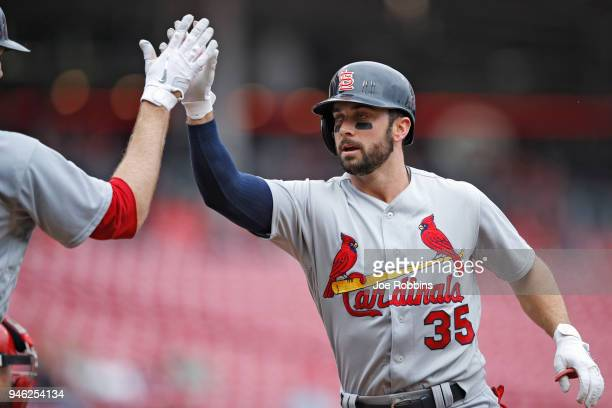 Greg Garcia of the St Louis Cardinals celebrates after hitting a solo home run in the second inning of the game against the Cincinnati Reds at Great...
