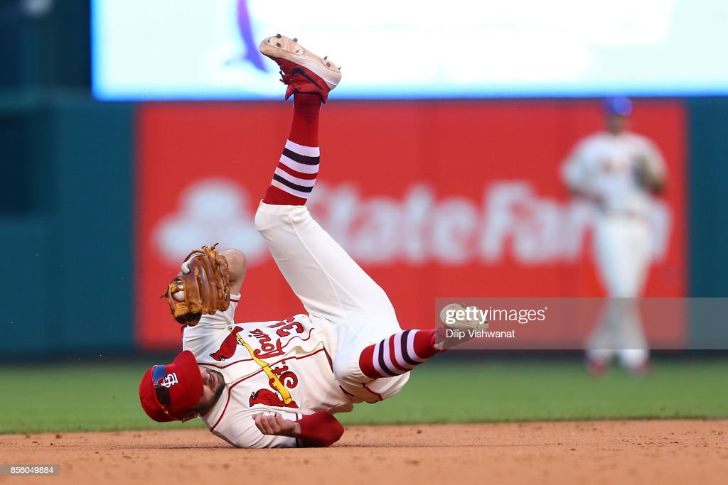 Greg Garcia #35 of the St. Louis Cardinals fields a ground ball against the Milwaukee Brewers in the ninth inning at Busch Stadium on September 30, 2017 in St. Louis, Missouri.