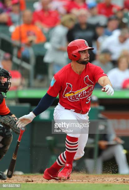Greg Garcia of the St Louis Cardinals in action against the Miami Marlins during a spring training game against the Miami Marlins at Roger Dean...