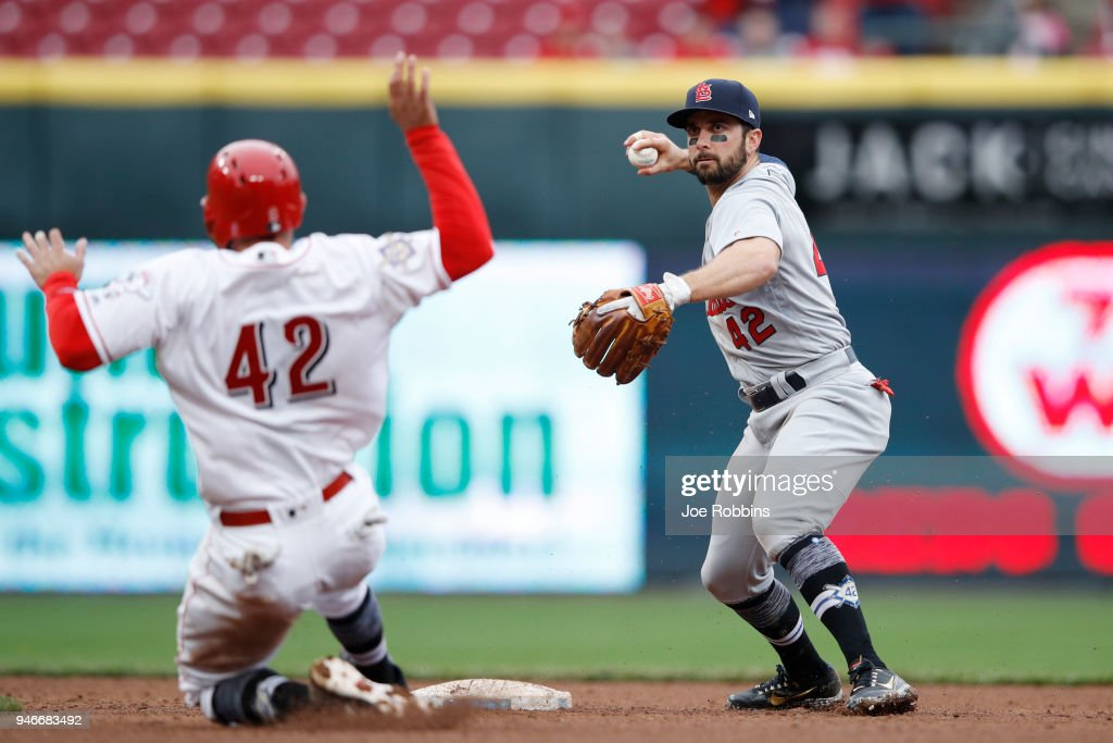 Greg Garcia #35 of the St. Louis Cardinals turns a double play after a ground ball by Joey Votto of the Cincinnati Reds in the eighth inning of the game at Great American Ball Park on April 15, 2018 in Cincinnati, Ohio. The Cardinals won 3-2. All players are wearing #42 in honor of Jackie Robinson Day.