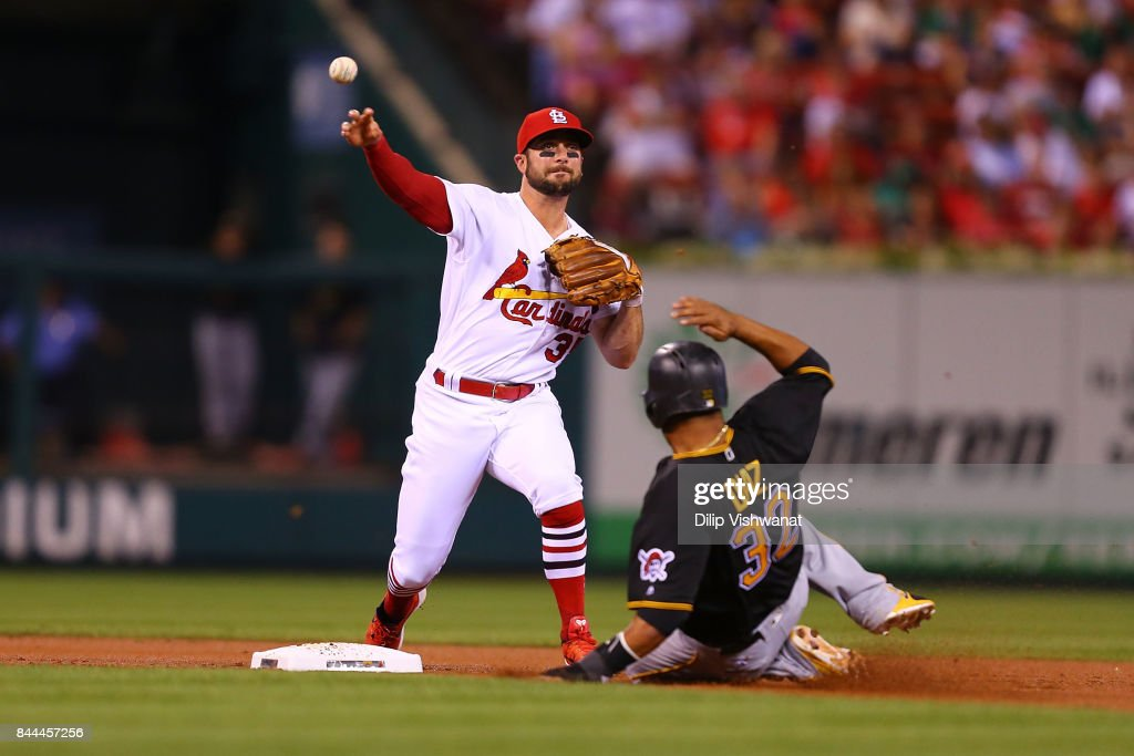 Greg Garcia #35 of the St. Louis Cardinals turns a double play against the Pittsburgh Pirates in the second inning at Busch Stadium on September 8, 2017 in St. Louis, Missouri.