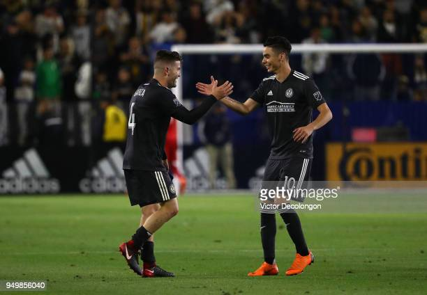 Greg Garza and Miguel Almiron of Atlanta United celebrate after their MLS match against the Los Angeles Galaxy at StubHub Center on April 21 2018 in...
