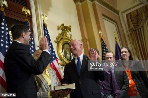 Greg Gianforte a Republican from Montana center is sworn in by House Speaker Paul Ryan a Republican from Wisconsin right during a ceremony in...