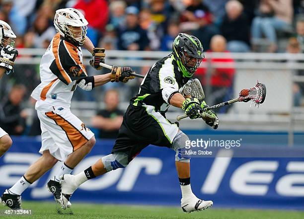 Greg Gurenlian of the Long Island Lizards carries the ball against the Rochester Rattlers at James M Shuart Stadium on April 27 2014 in Hempstead New...