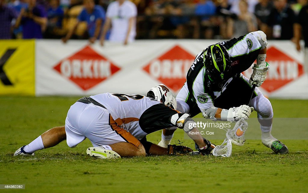 Greg Gurenlian #32 of the New York Lizards against Mike Poppleton #92 of the Rochester Rattlers during the 2015 Major League Lacrosse Championship Game at Fifth Third Bank Stadium on August 8, 2015 in Kennesaw, Georgia.