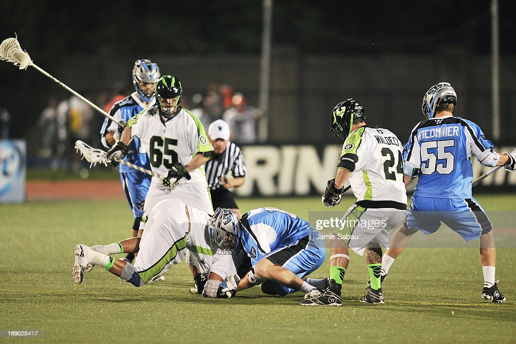 Greg Gurenlian #32 of the New York Lizards and Eric O'Brien #10 of the Ohio Machine battle for control of the face off in the third period as players for both teams wait for the ball to pop out on May 18, 2013 at Selby Stadium in Delaware, Ohio. New York defeated Ohio 14-8.