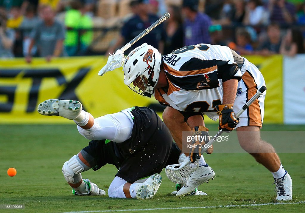 Greg Gurenlian #32 of the New York Lizards is upended in a faceoff against Mike Poppleton #92 of the Rochester Rattlers during the 2015 Major League Lacrosse Championship Game at Fifth Third Bank Stadium on August 8, 2015 in Kennesaw, Georgia.