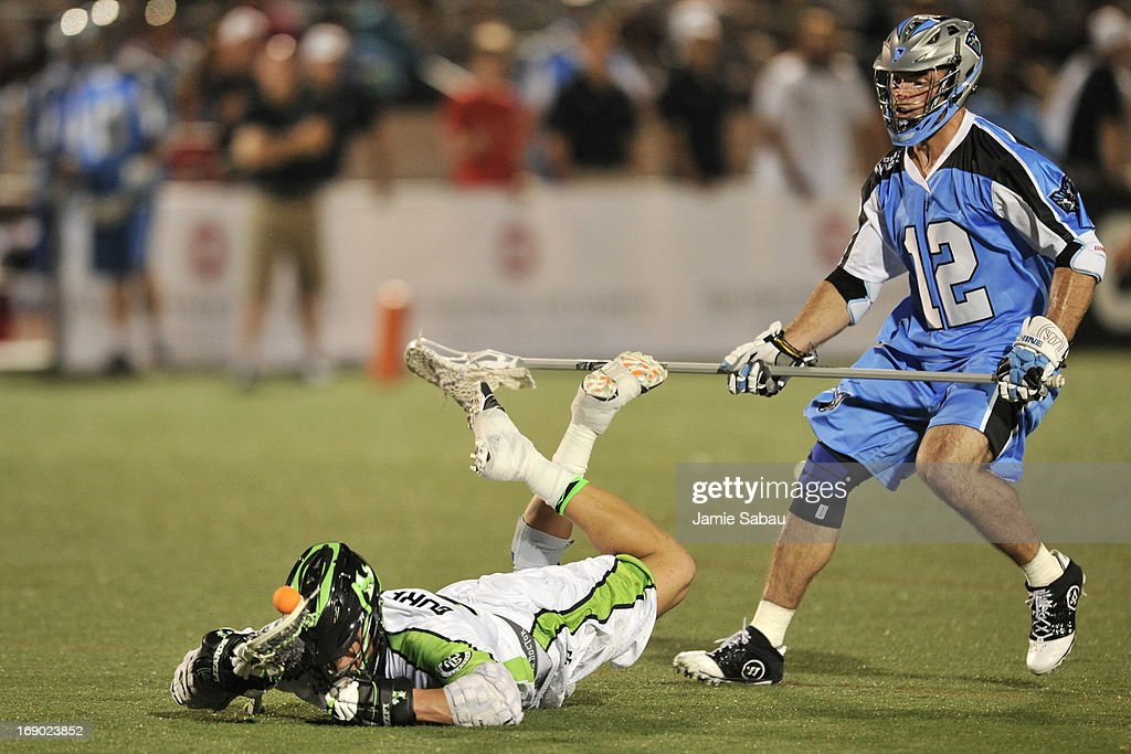 Greg Gurenlian #32 of the New York Lizards loses control of the ball after tripping up and falling over as Ray Megill #12 of the Ohio Machine defends in the second half on May 18, 2013 at Selby Stadium in Delaware, Ohio. New York defeated Ohio 14-8.