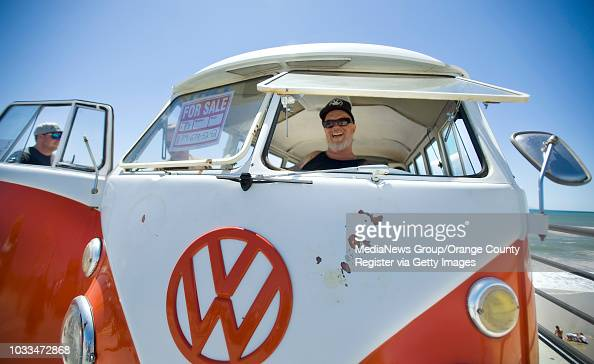 Greg Hale shows passersby how easily the engine turns on his 1965 VW
